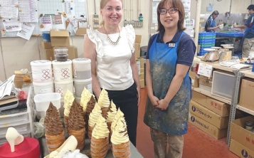 Irina Mironova with a master of desserts in the workshop of one of the factories of the Iwasaki holding