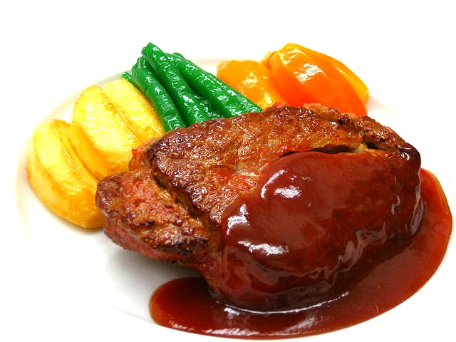 Replica of beef steak with wine sauce and vegetables