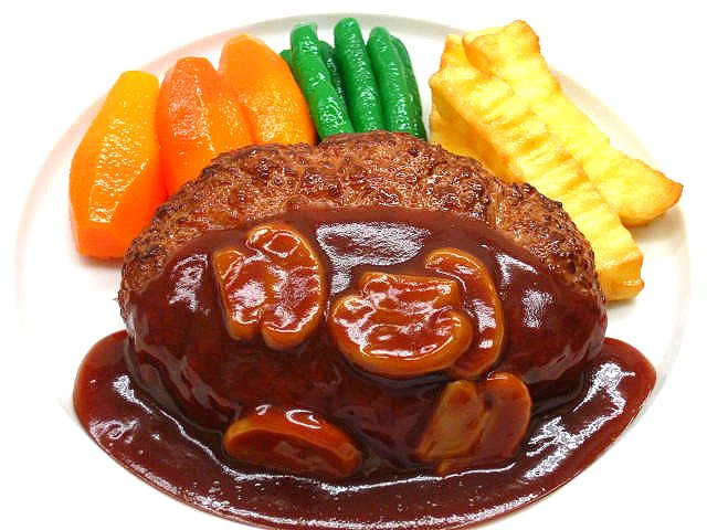 A replica of cutlet with mushroom sauce and vegetables