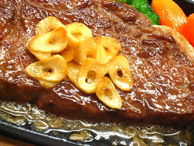 Replica of baked marbled beef with roasted garlic