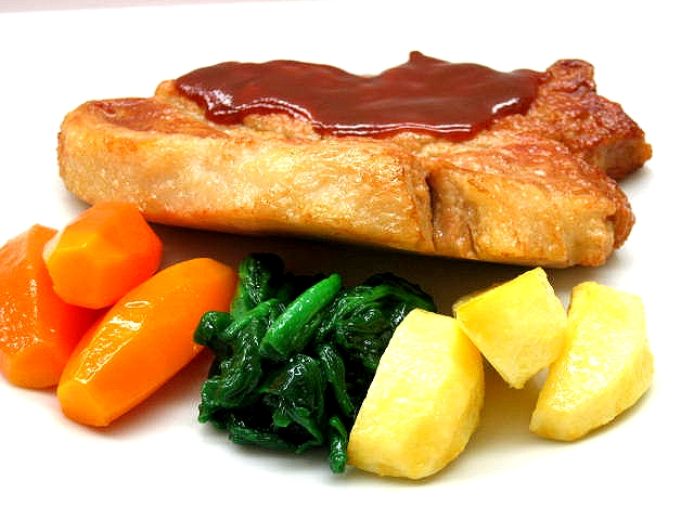 Replica of fried pork with wine sauce and vegetables