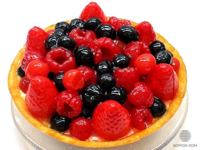 A model of cheesecake with cranberries, blueberries, raspberries, strawberries