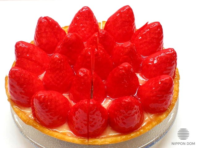 A model of cheesecake with strawberry