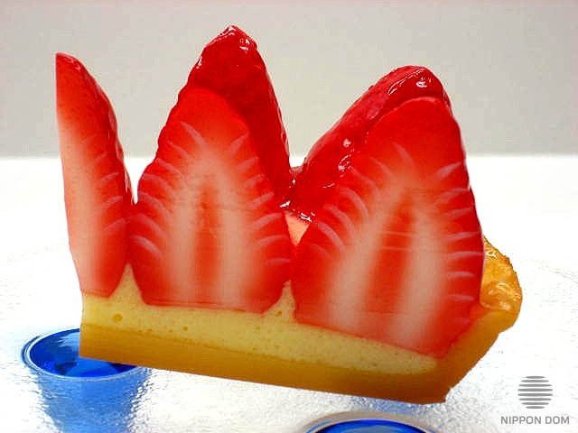 A replica of cheesecake with strawberry