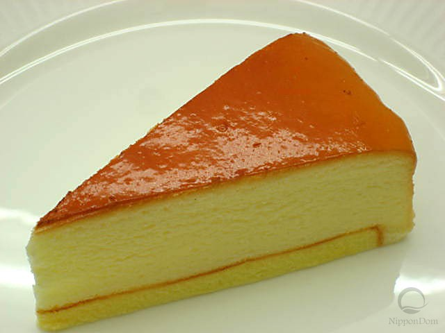 A replica of cheesecake covered with sugar glaze